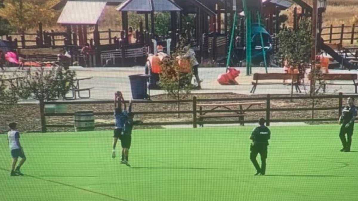 Officers play football with kids in Colorado Springs.