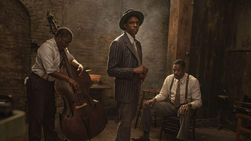 This image released by Netflix shows Michael Potts, from left, Chadwick Boseman and Colman...