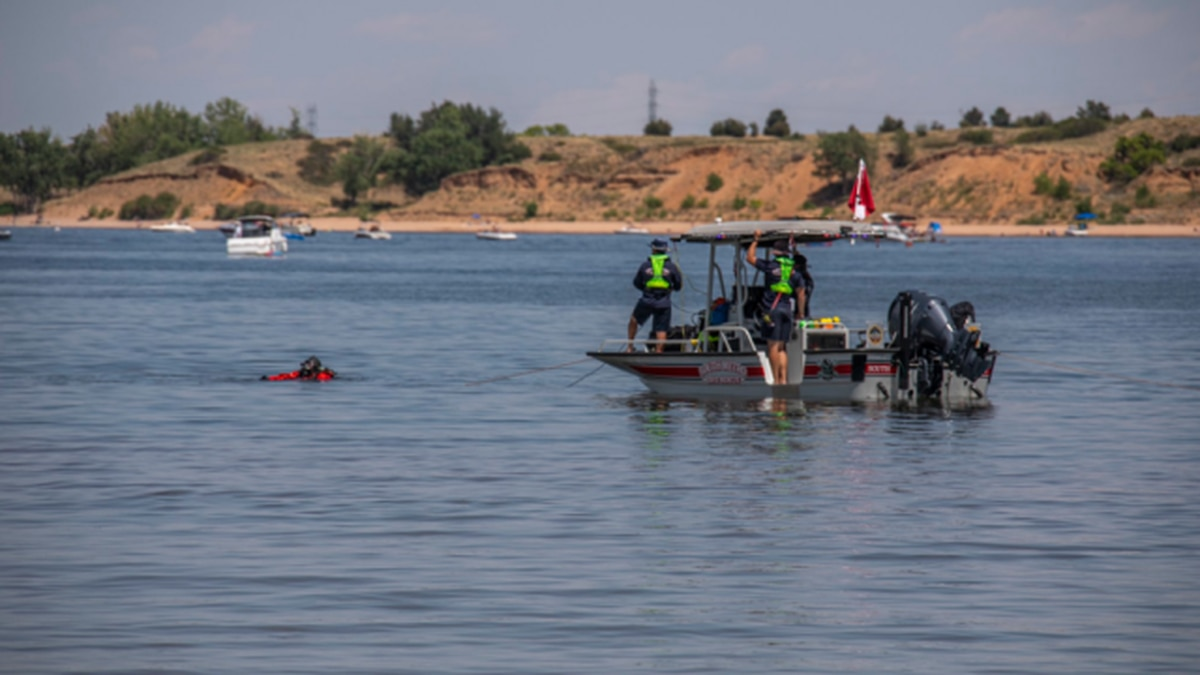 Rescue crews search the Chatfield Reservoir for a teen drowning victim, last seen July 31, 2020.  A body, presumed to be the 18-year-old, was recovered on Aug. 5, 2020.