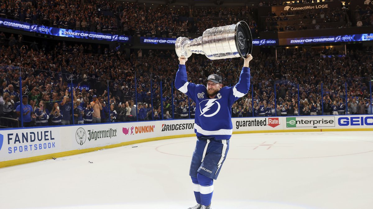 Tampa Bay Lightning's Steven Stamkos hoists the Stanley Cup after the team's 1-0 victory...