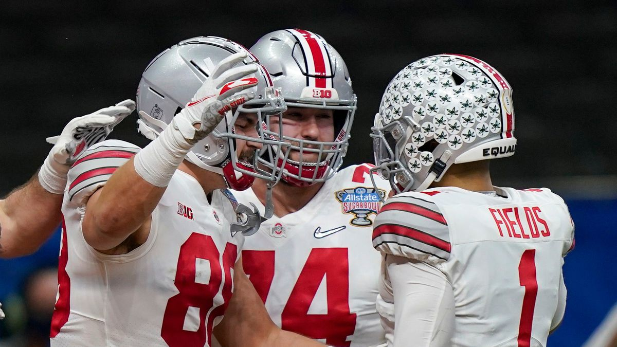 Ohio State tight end Jeremy Ruckert, left, celebrates his touchdown with quarterback Justin...
