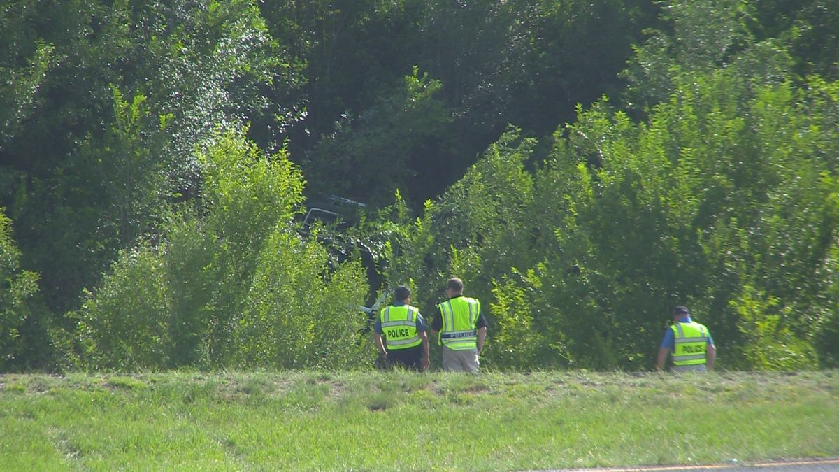 """The vehicle landed behind where the officers are standing in a drainage area with heavy undetgrowth.  """"It's hidden in that area,"""" said CSPD spokesperson Sgt. Castro."""