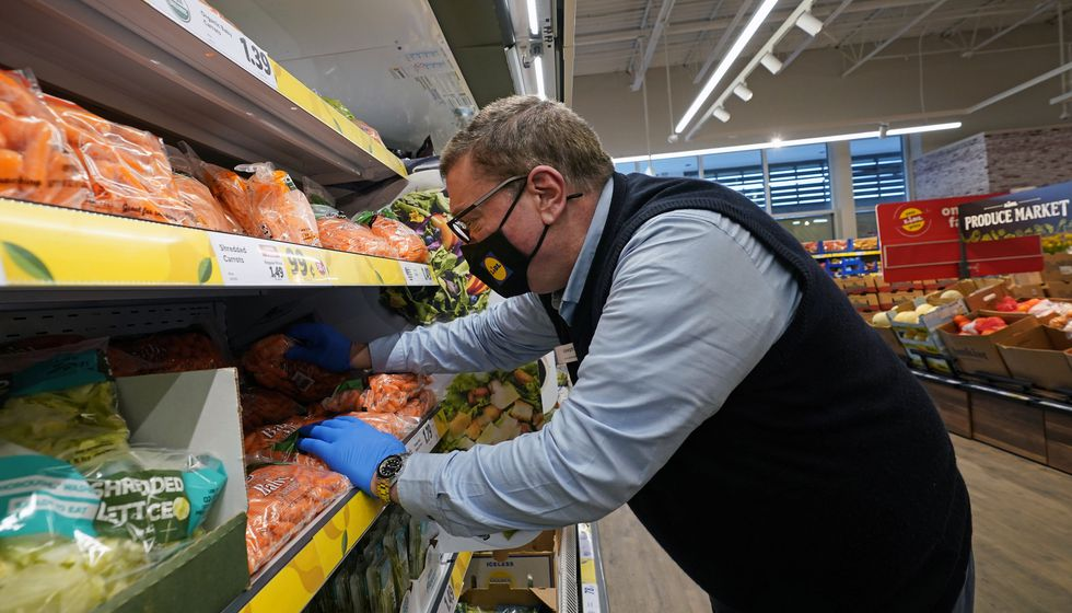 In this Thursday, Feb. 4, 2021 photo, Joseph Lupo, an employee of the grocery chain Lidl,...