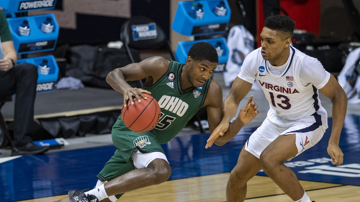 Ohio guard Lunden McDay (15) makes a move on Virginia guard Casey Morsell (13) during the...