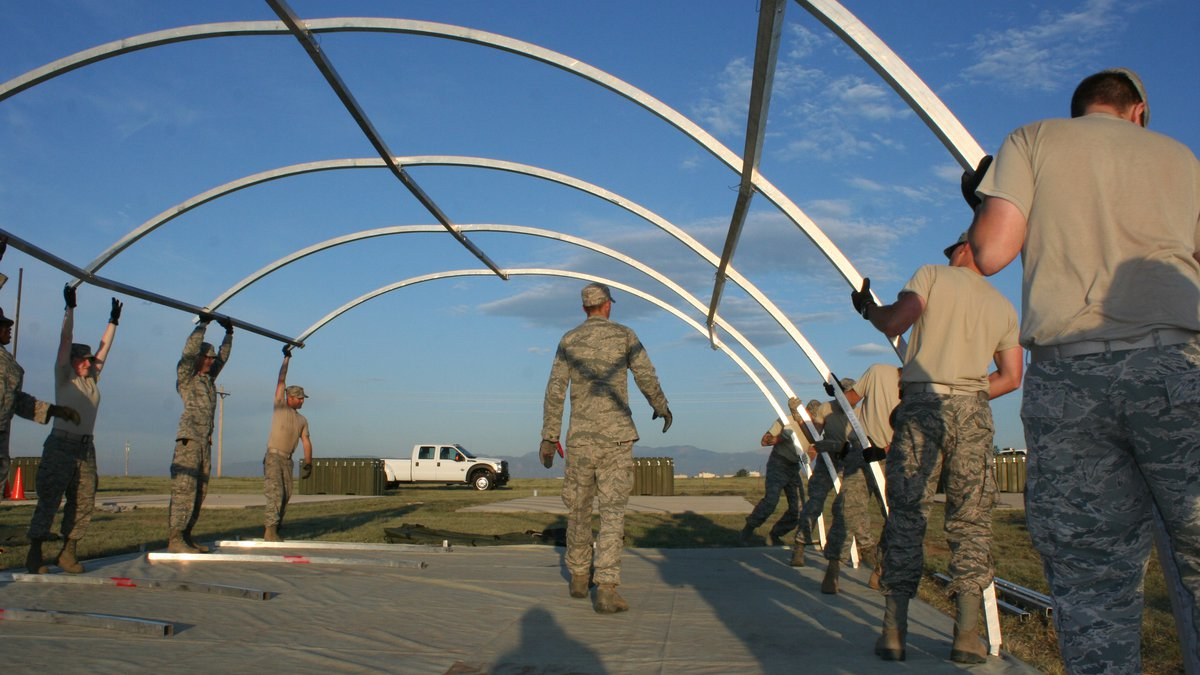 Members of the 50th Civil Engineer Squadron erect the frame of an Alaskan shelter during Prime...
