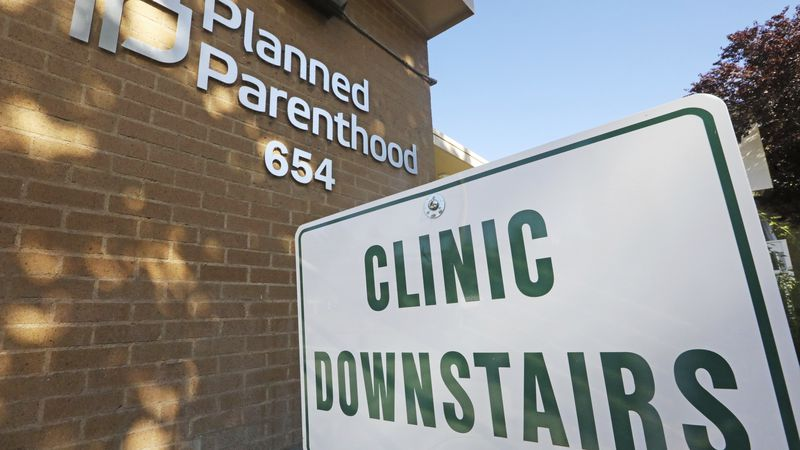 FILE - In this Aug. 21, 2019, file photo, a sign is displayed at Planned Parenthood of Utah in...