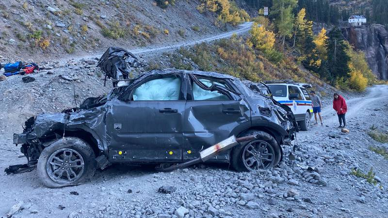 A woman and her dog were injured after rolling off the road near Black Bear Pass and Bridal...