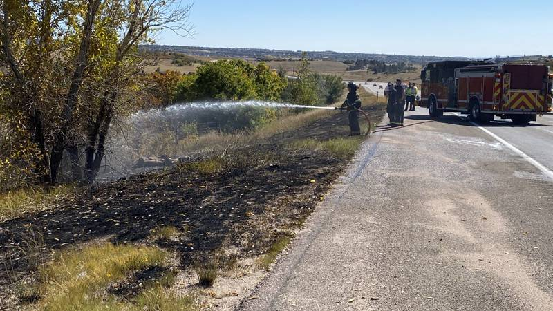 A firefighter putting out a hotspot on Highway 83 just north of Shoup Road.