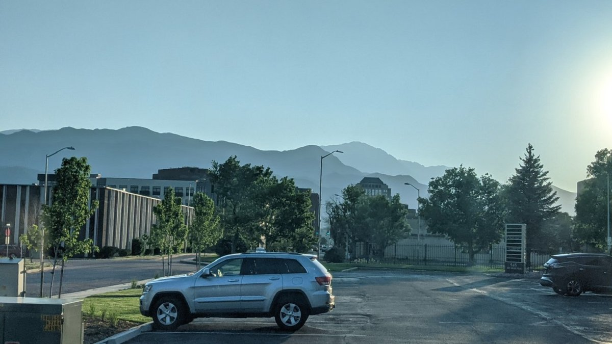 People noticed a haze over the mountains from Colorado Springs on 6/8/21. The smoke is from two...