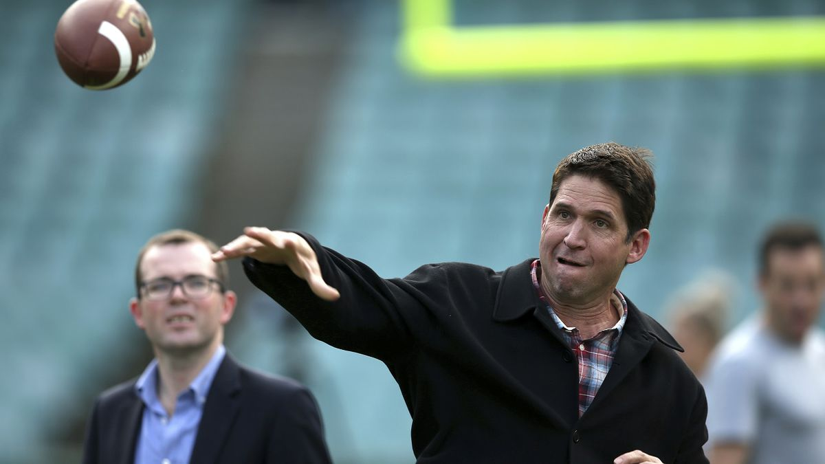 Three-time Super Bowl champion Ed McCaffrey throws a ball during a promotion for the Sydney Cup in Sydney, Australia,Thursday, May 18, 2017. Stanford University, and Rice will play the opening game of the college football season in Sydney on Aug. 27. (AP Photo/Rick Rycroft)
