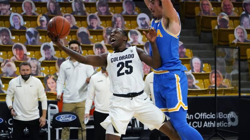 Colorado guard McKinley Wright IV looks for a shot as UCLA guard Jaime Jaquez Jr. defends...