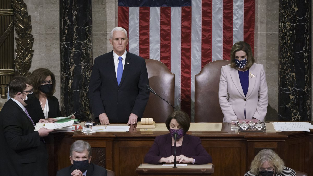 Vice President Mike Pence and Speaker of the House Nancy Pelosi, D-Calif., read the final...