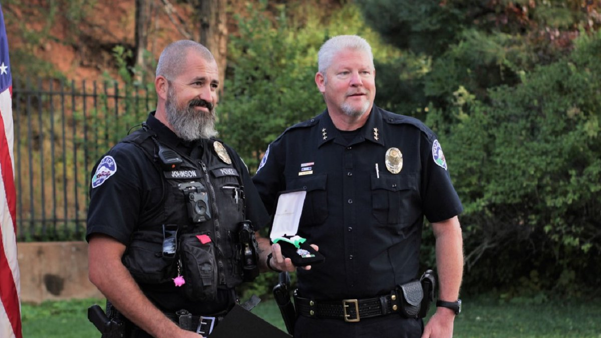 """Officer Johnson (pictured on the left) was presented with the """"Life Saving Medal"""""""