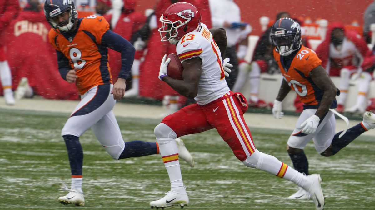 Kansas City Chiefs kick returner Byron Pringle runs a kickoff back for a touchdown as Denver...