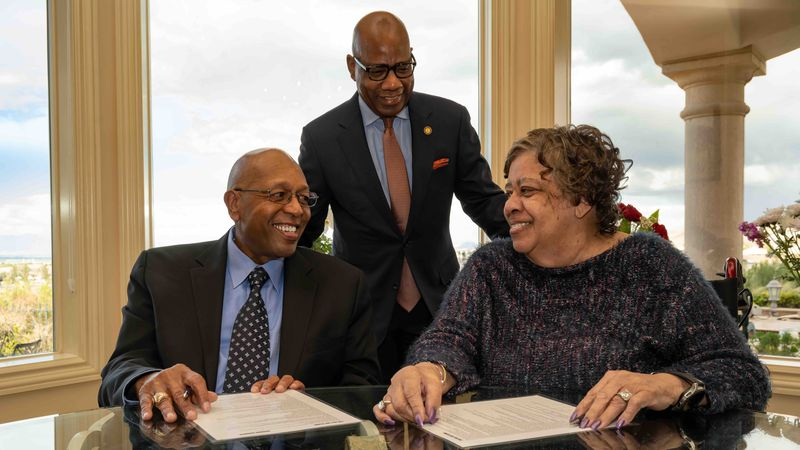 In this photo provided by Morgan State University, Calvin Tyler Jr. and his wife, Tina, smile...
