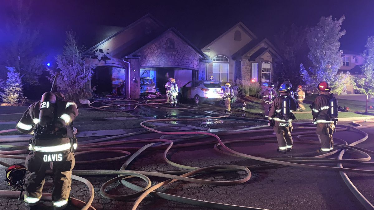 Twenty-seven firefighters battled a large garage fire that spread into a north Springs home late on the night of Aug. 7, 2020.