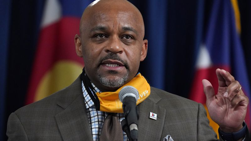 FILE - In this Nov. 17, 2020 file photo Denver Mayor Michael Hancock makes a point during a...