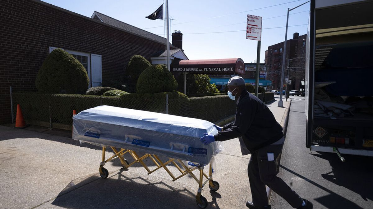FILE - In this Friday, March 27, 2020 file photo, William Samuels delivers caskets to the...