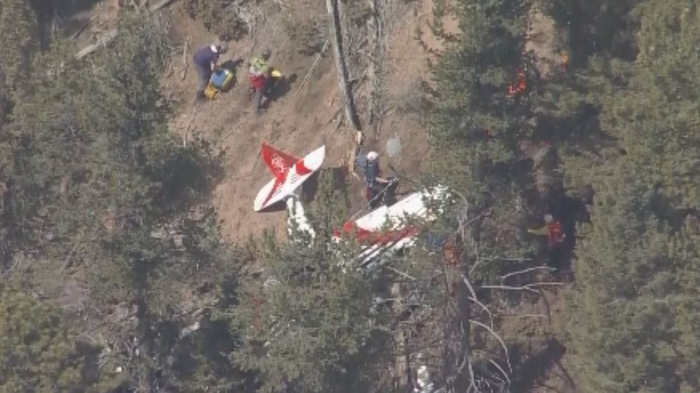 Search and rescue crews are hiking to the site of crashed plane in a remote part of central...