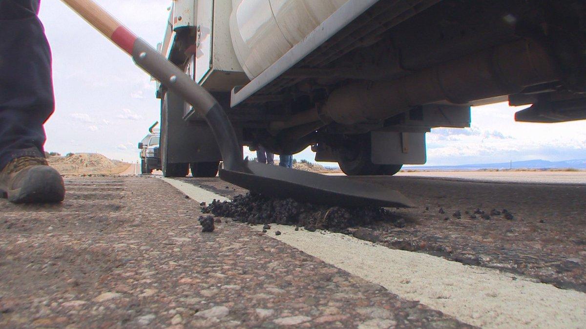 Colorado Department of Transportation crews fix potholes along Highway 50 on March 14, 2019.