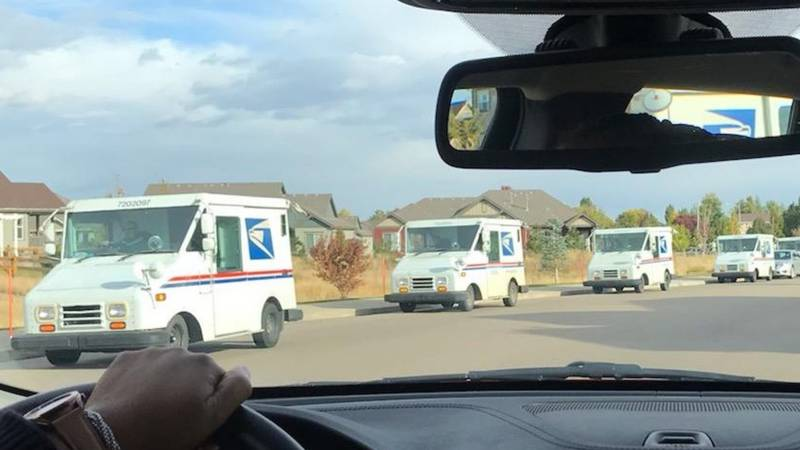 47 United States Postal vehicles drove the route of the Longmont worker killed Wednesday.