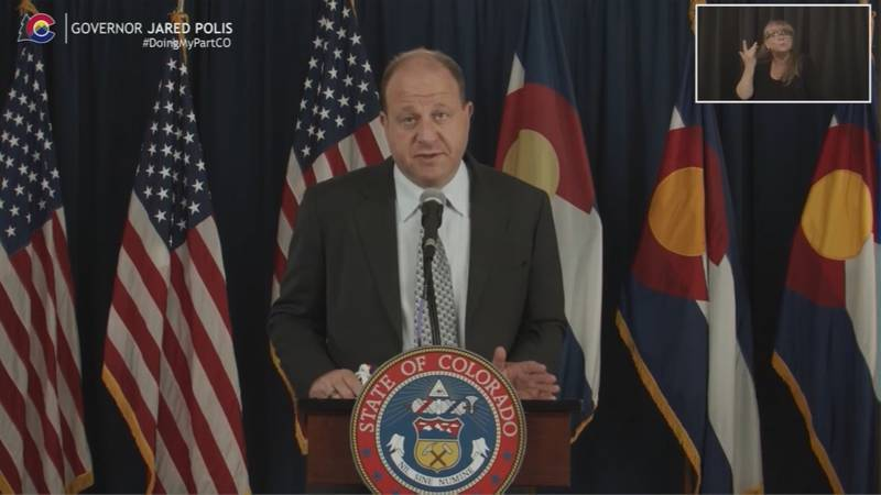 Gov. Jared Polis during an April 2021 COVID-19 news conference.