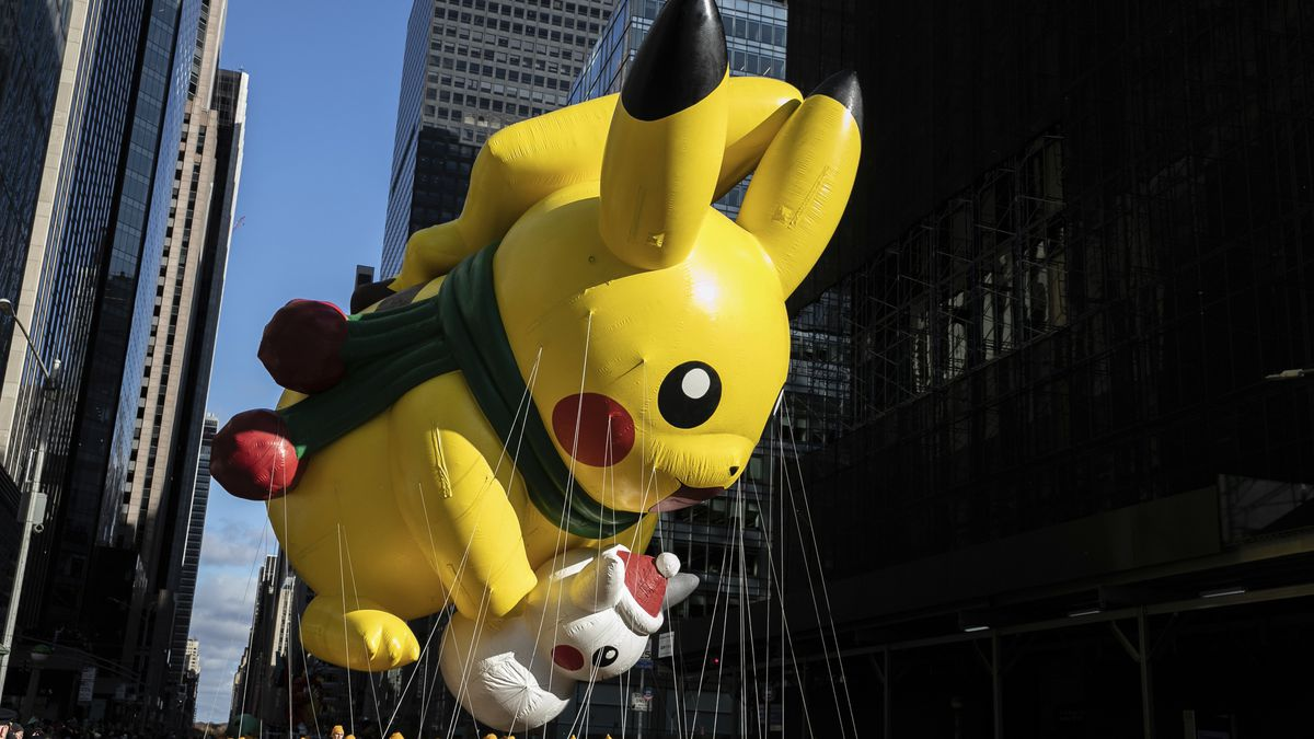 A Pikachu balloon makes its way down New York's Sixth Avenue during the Macy's Thanksgiving Day Parade, Thursday, Nov. 28, 2019, in New York.