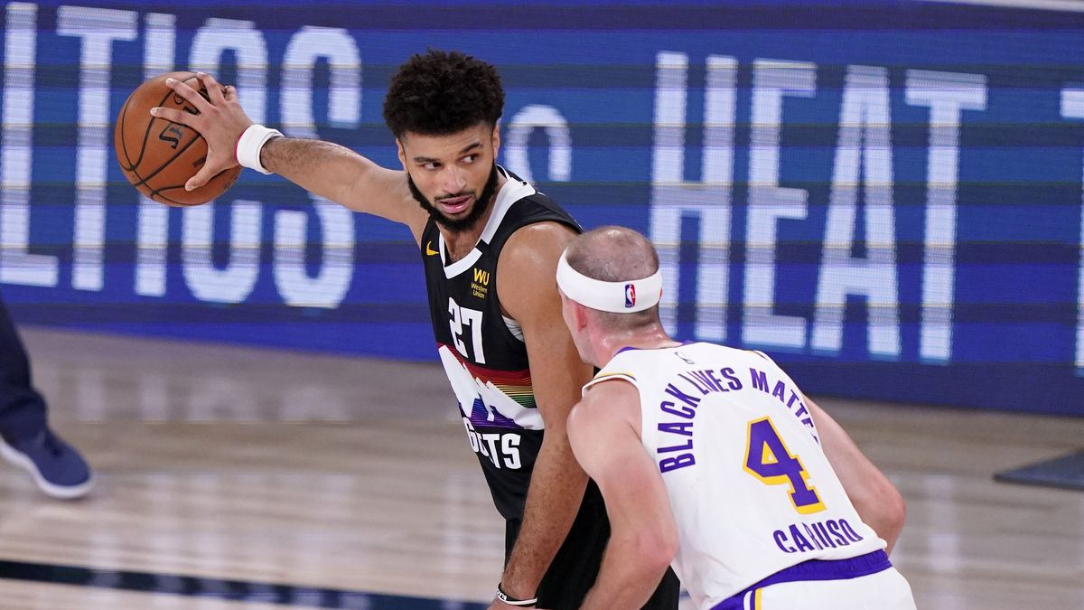 Denver Nuggets' Jamal Murray (27) looks for an opening against Los Angeles Lakers' Alex Caruso (4) during the second half of Game 3 of the NBA basketball Western Conference final Tuesday, Sept. 22, 2020, in Lake Buena Vista, Fla. (AP Photo/Mark J. Terrill)