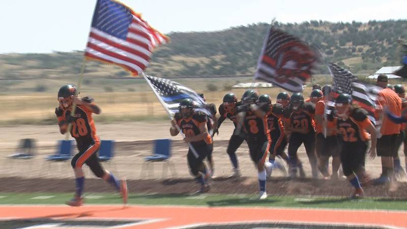 The Branson/Kim Bearcats run onto their new astroturf field Sept 11, in the home opener of...