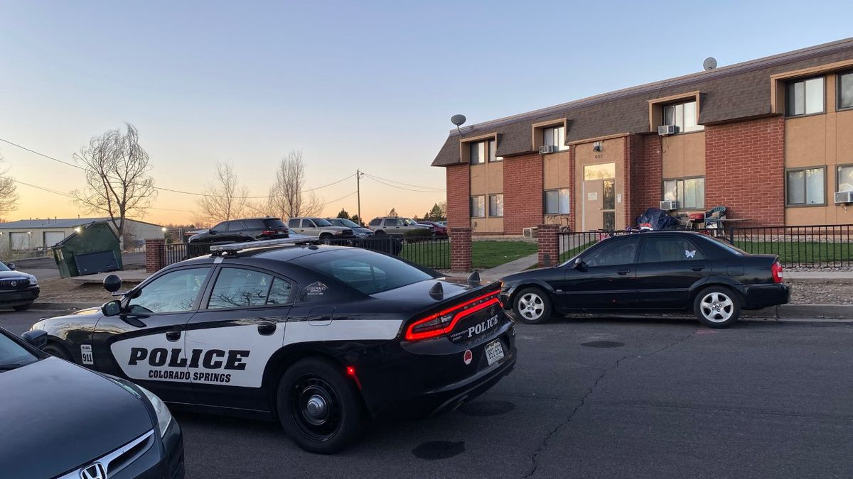 Springs police officers at the scene of a shooting on Santa Fe Street near Fountain and...
