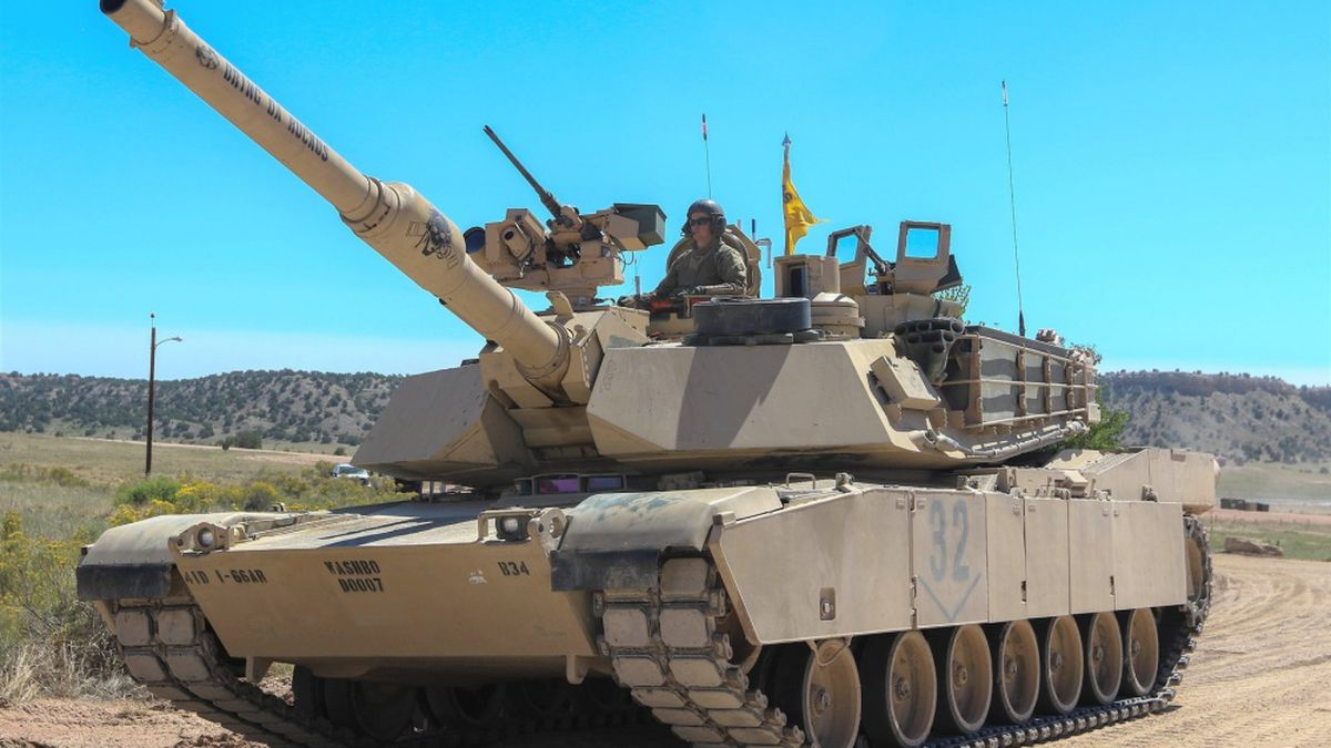 A tank crew from 1st Battalion, 66th Armor Regiment, 3rd Armored Brigade Combat Team, 4th...