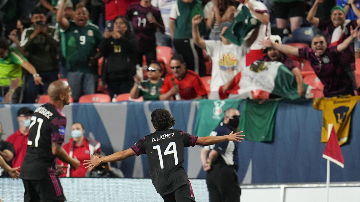 Mexico's Diego Lainez (14) celebrates a goal against the United States during the second half...