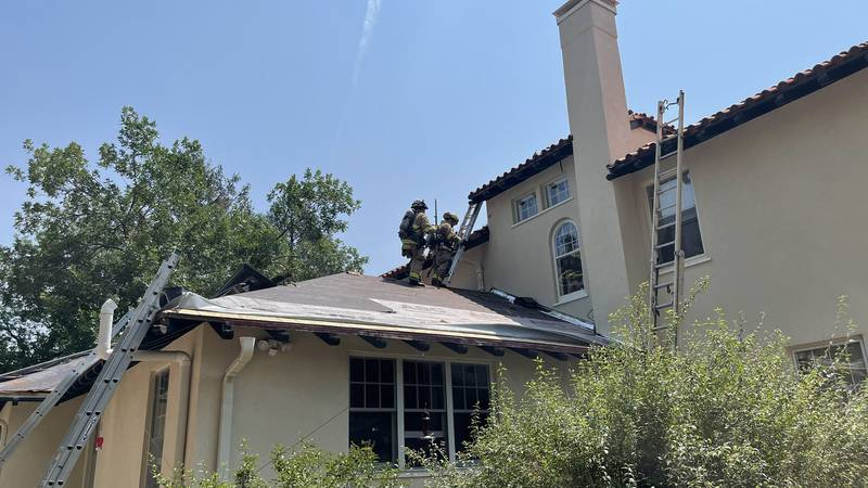 Springs firefighters took to the roof of the house to battle the attic fire.