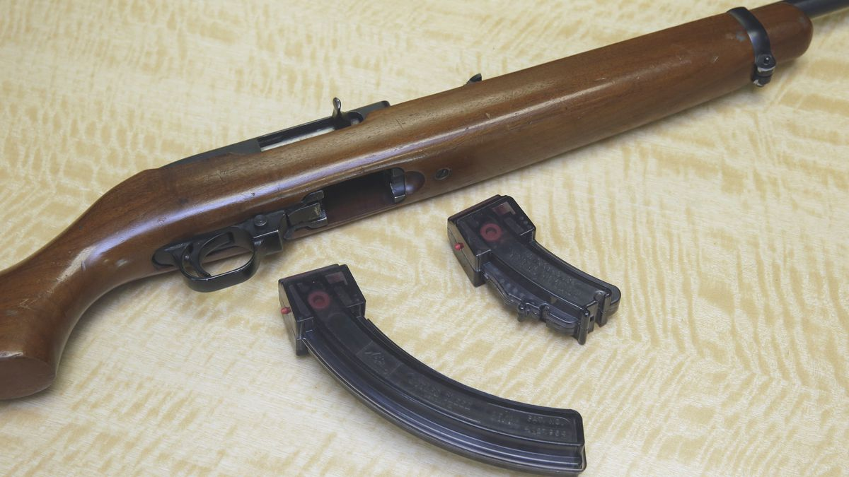 A semi-automatic rifle is displayed with a 25 shot magazine, left, and a 10 shot magazine, right, at a gun store in Elk Grove, Calif.