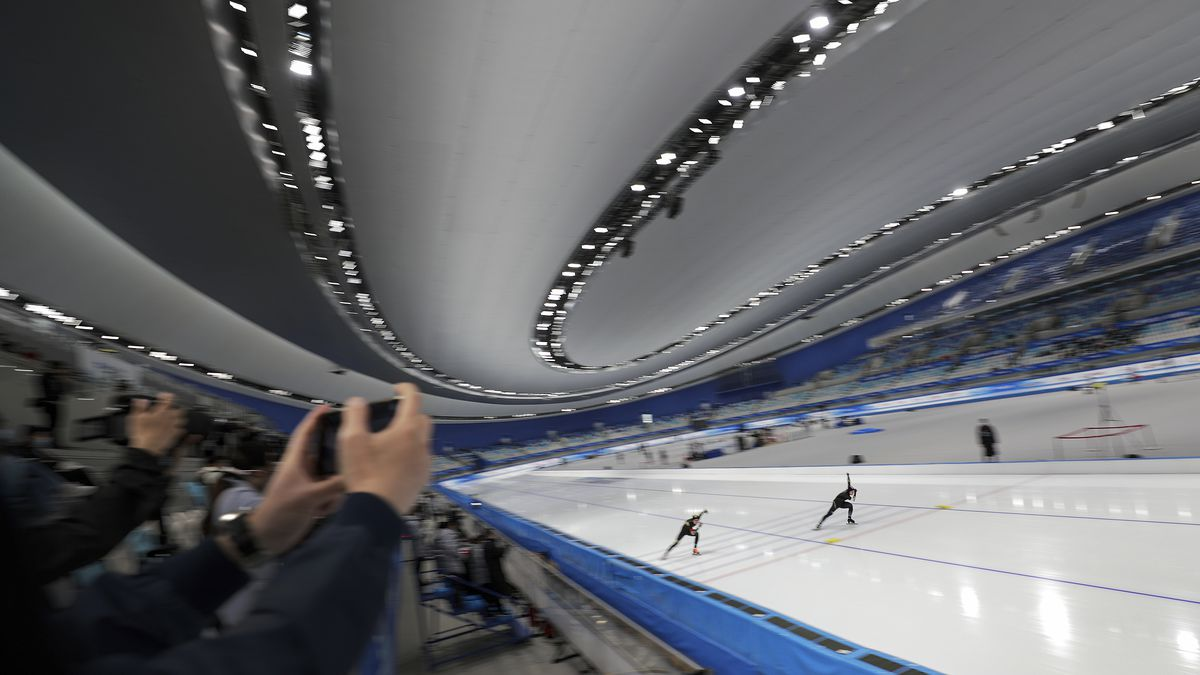 Chinese skaters Ma Kaiwen, left, and Chen Chuang compete in the men's 500 meters race during a...