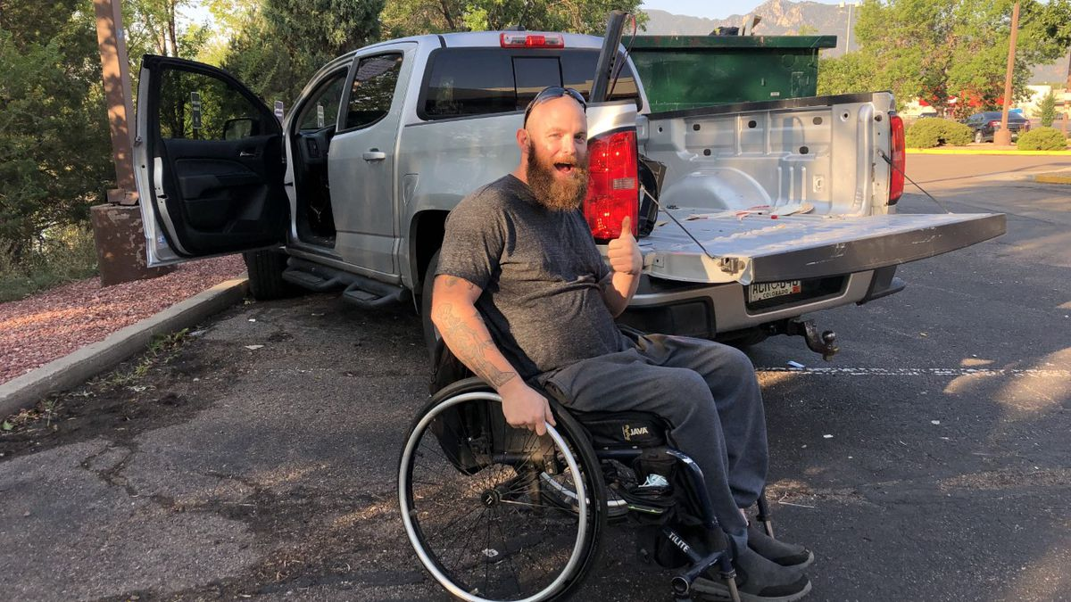 Perrin Nicolson next to his specialized vehicle, which was recovered Aug. 20, 2020 after it was stolen over the previous weekend.