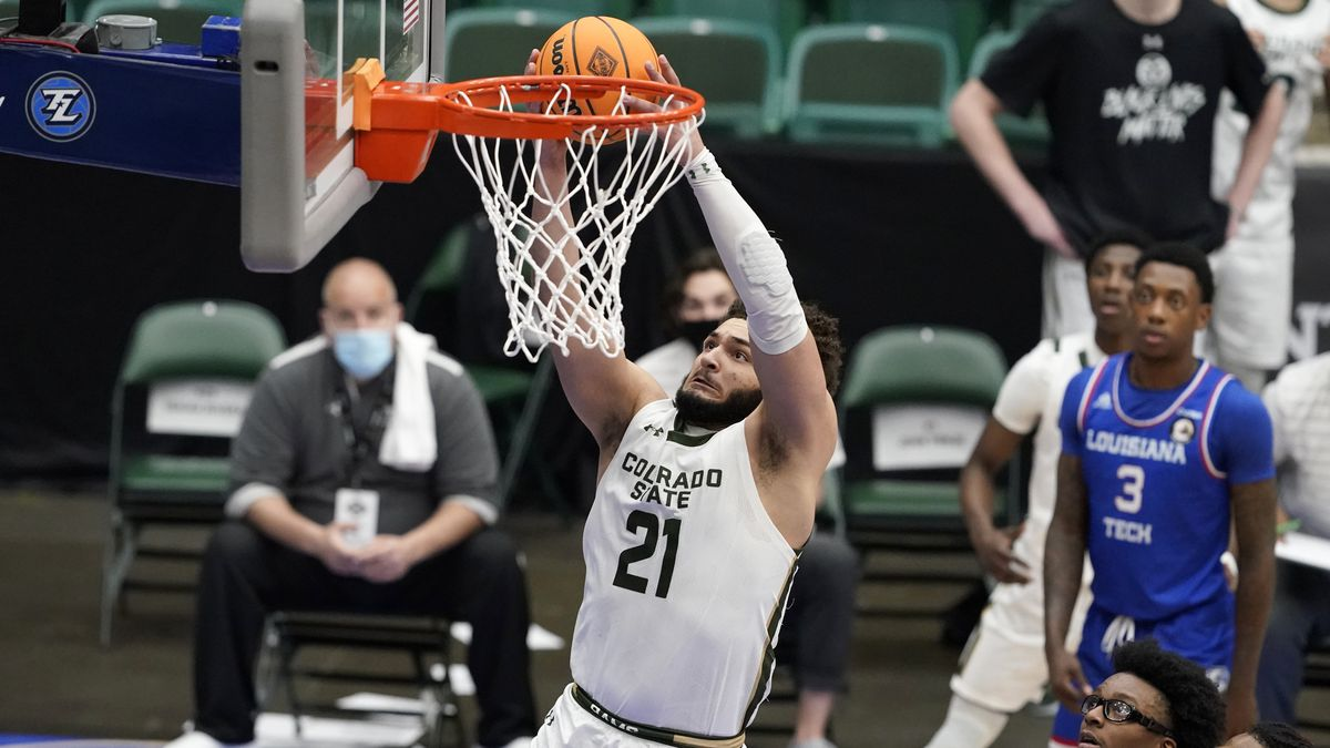 Colorado State guard David Roddy (21) gets through Louisiana Tech defenders to sink a basket...