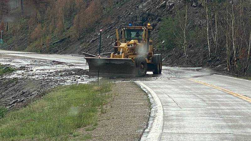 CDOT cleaning up mud from highway.
