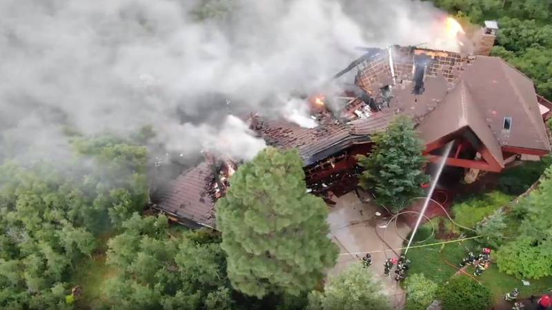 A drone captures an overhead view of a large house fire in Douglas County, Colorado on July 17,...