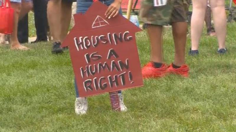 """A sign at the protest reading """"housing is a human right!"""""""