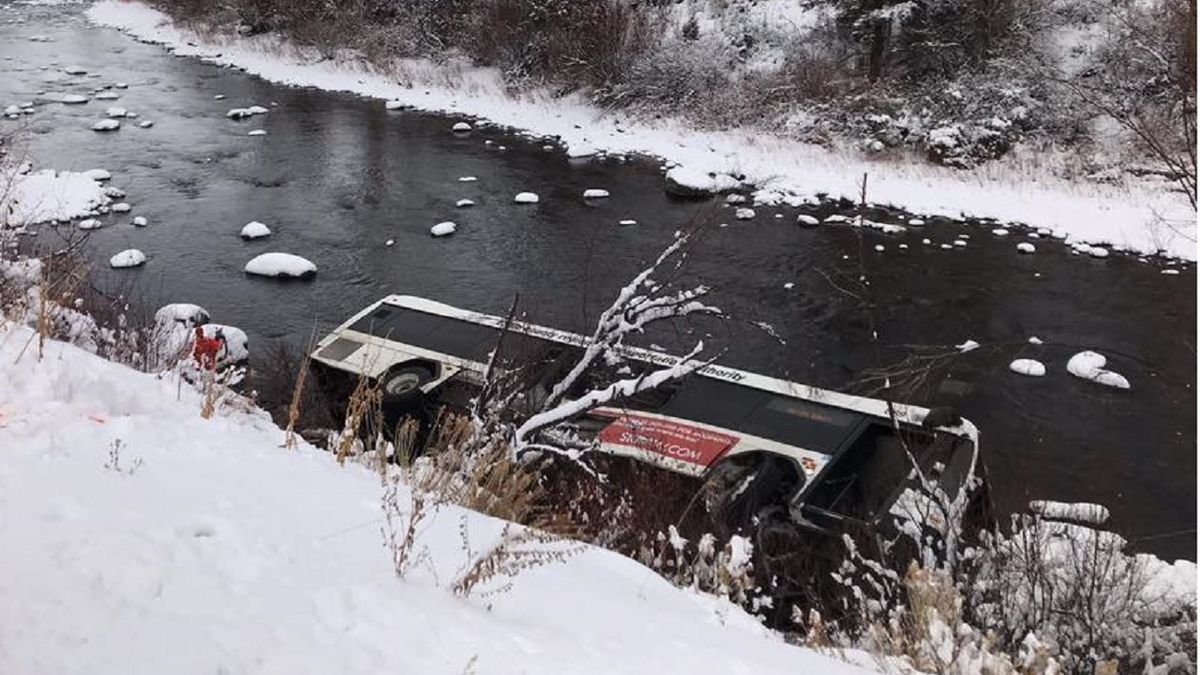 A bus ended up in a Colorado river on 12/13/19 following a crash.  Photo courtesy Eagle River Fire Protection District.