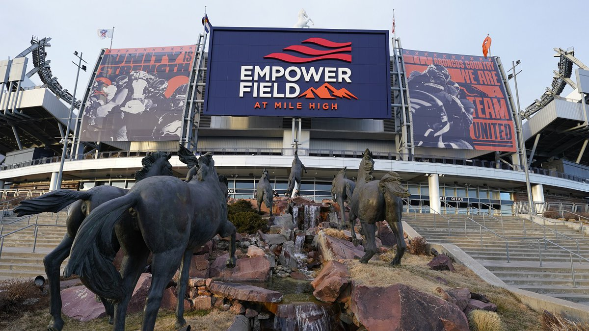 Sun illuminates Empower Field at Mile High, the home of the NFL's Denver Broncos, late...