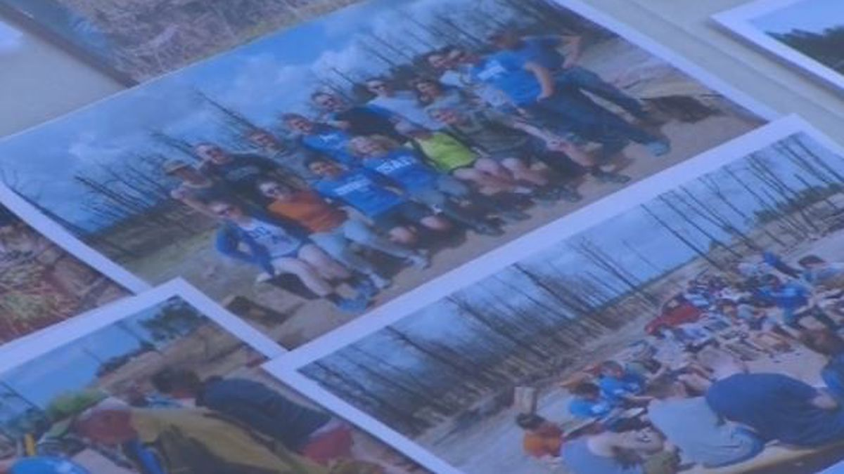 Pictures set out on display of volunteers who helped rebuild after the fire.
