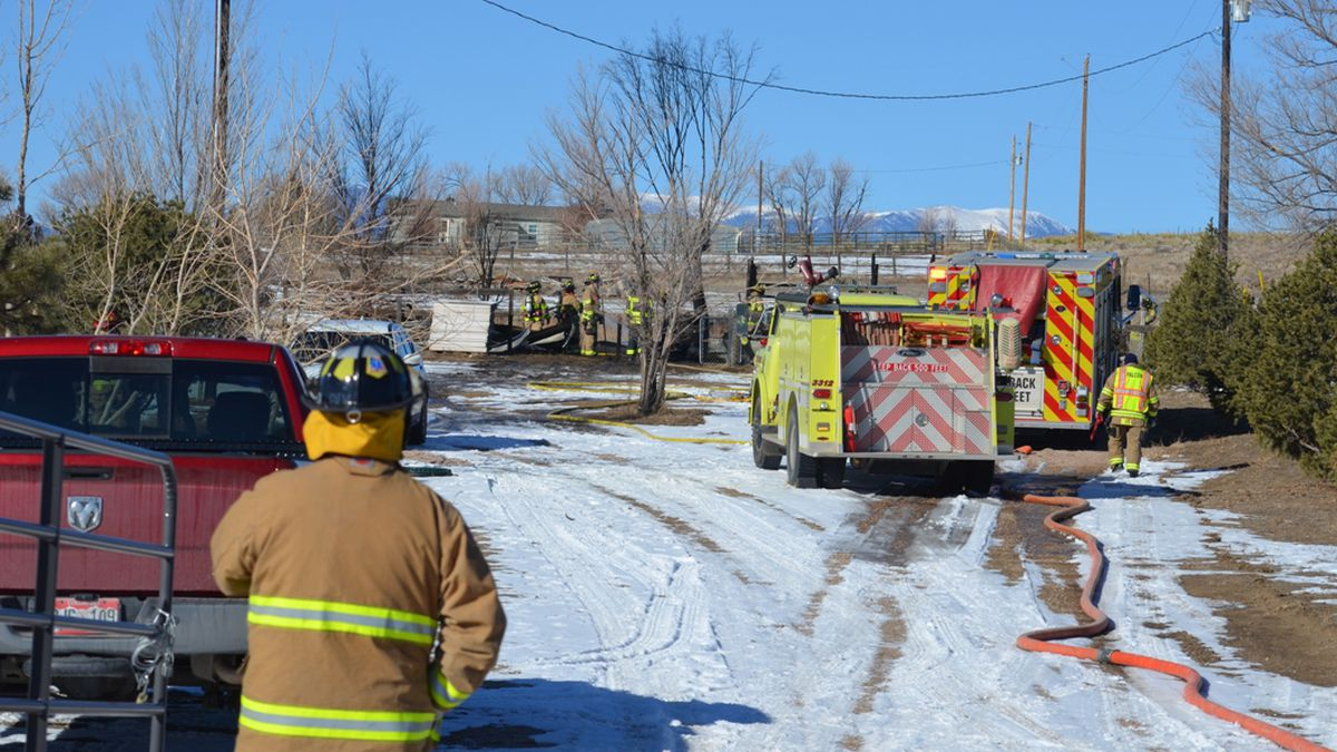 Firefighters at the scene of a chicken coop fire in eastern El Paso County on Feb. 21, 2021. ...