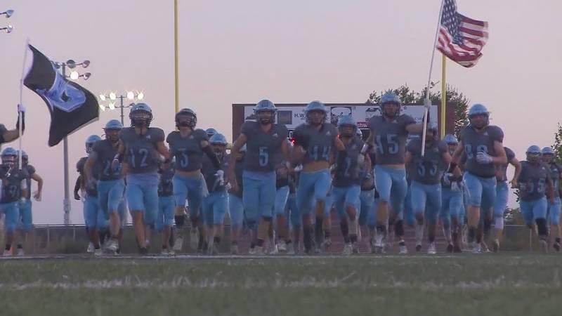 Pueblo West football runs onto the field against Palmer Ridge Friday night at Cyclones Stadium