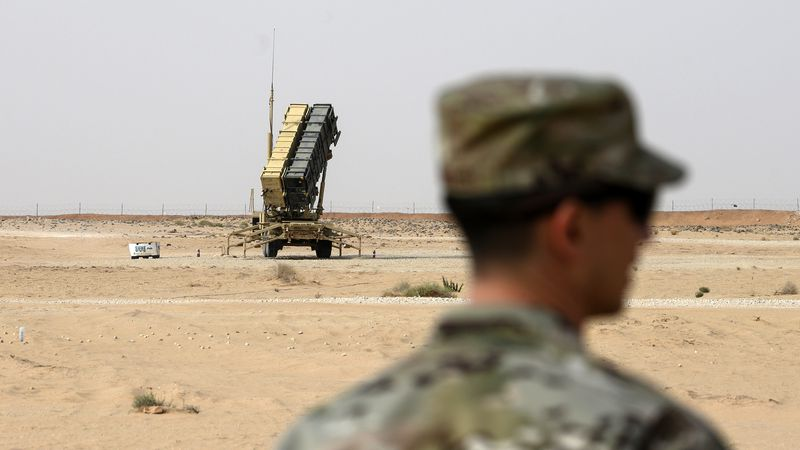 FILE - In this Feb. 20, 2020 file photo, a member of the U.S. Air Force stands near a Patriot...