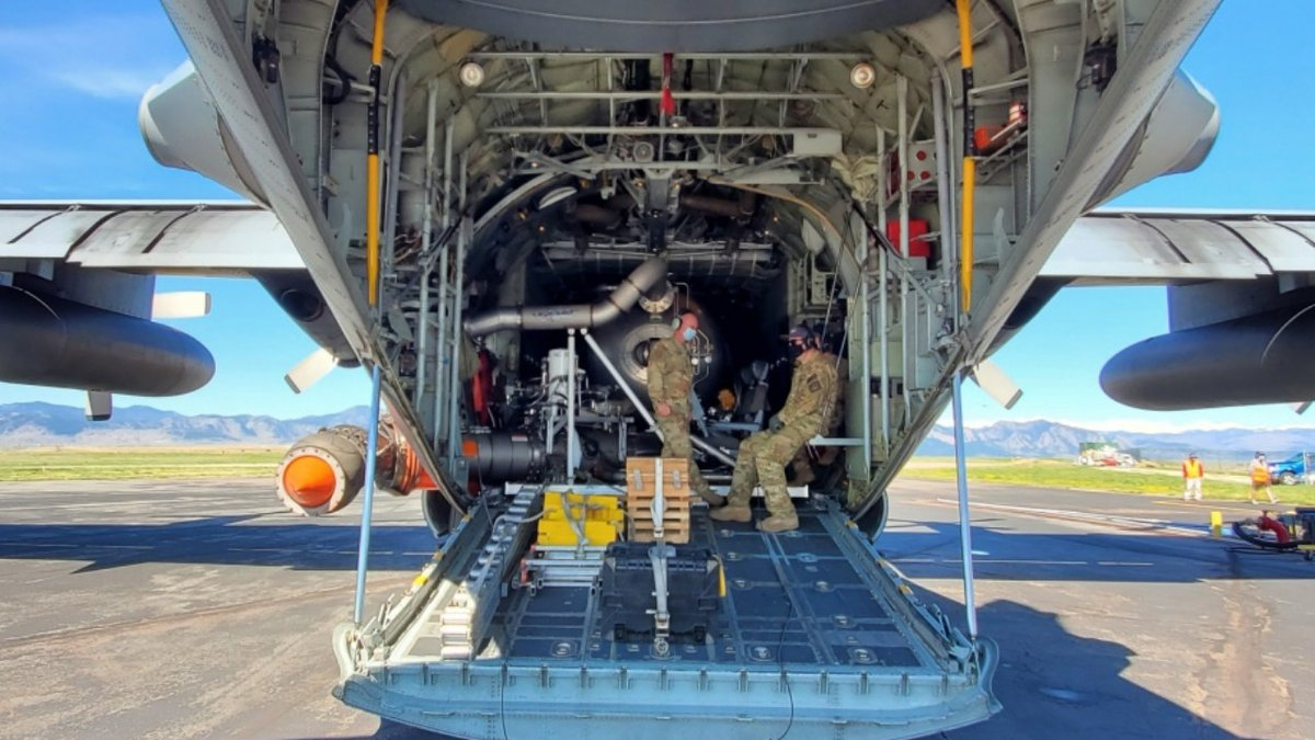Members of the Air Force Reserve's 302nd Airlift Wing and the Forest Service prepare a C-130...