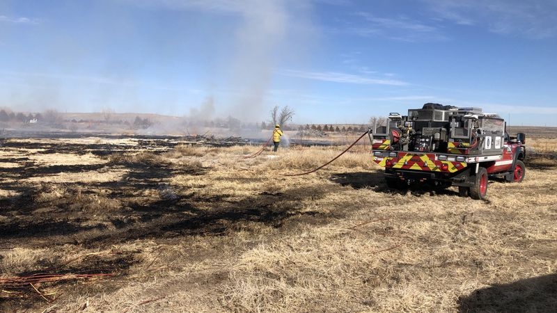 Several emergency crews in Pueblo County were able to contain and put out a large grass fire...