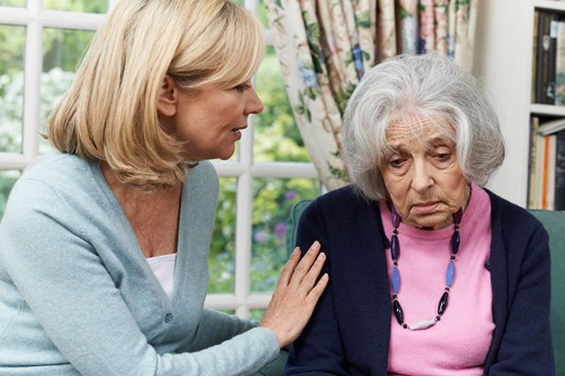 Mature Female Friend Comforting Unhappy Senior Woman