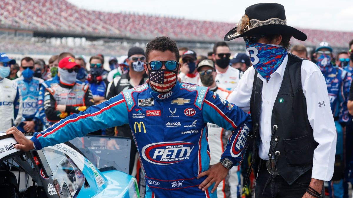 FILE - Team owner Richard Petty, right, stands with driver Bubba Wallace prior to the start of the NASCAR Cup Series at the Talladega Superspeedway in Talladega, Ala., Monday, June 22, 2020.
